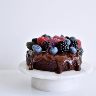 Chocolate almond cake with ganache and berries