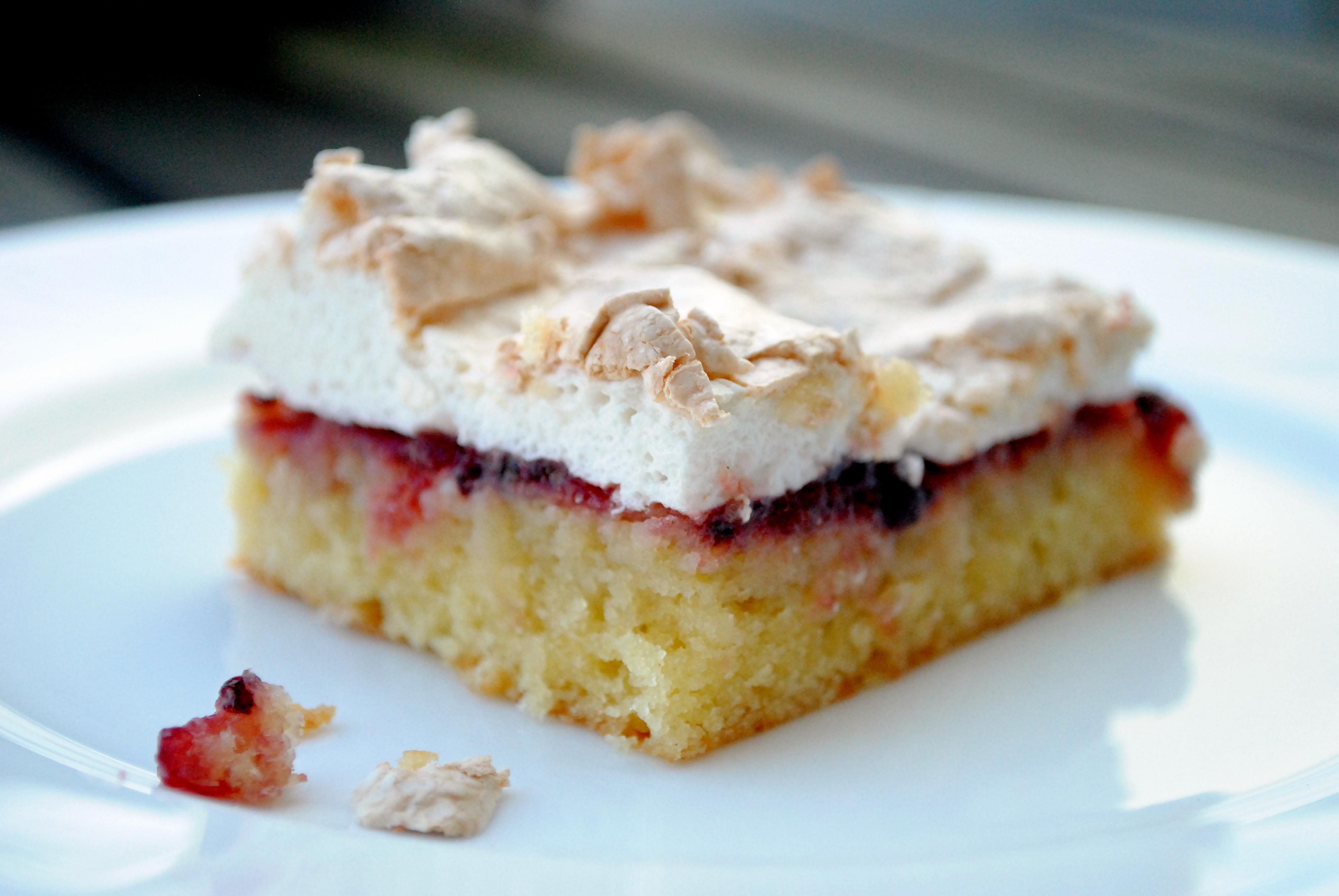 Cake with raspberry jam and meringue