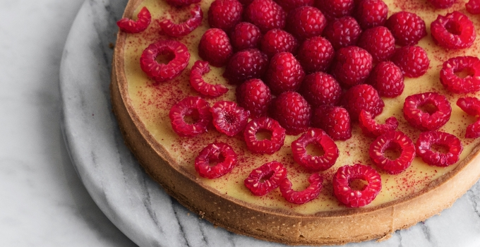 Passionfruit tart with frangipane and raspberries