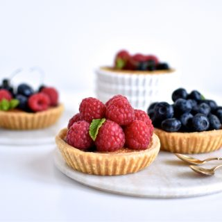 Small frangipane tarts with lots of berries