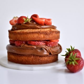 Almond cake with salted caramel ganache and strawberries